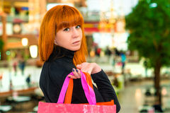 Girl holding shopping bags Stock Images