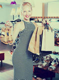 Girl holding shopping bags and pair of shoes Royalty Free Stock Images