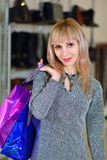 Girl holding shopping bags at the store background Stock Photos