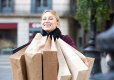 Girl holding shopping paper bags Royalty Free Stock Photo