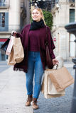Girl holding shopping paper bags Stock Photos