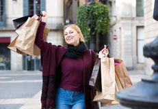 Girl holding shopping paper bags Royalty Free Stock Image