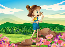 A girl holding a shovel at the flower garden Royalty Free Stock Image