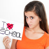 Girl holding a sign with the words I hate school Stock Images