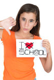 Girl holding a sign with the words I hate school Stock Photos