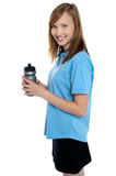 Girl holding sipper bottle. Break from gym workout Royalty Free Stock Images