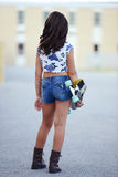 Girl holding skate board Royalty Free Stock Photography
