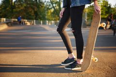 A girl is holding a skate by her hand. Close-up. stock images