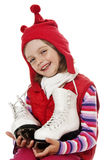Girl holding skates Stock Images