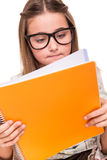 Girl holding a sketchbook Stock Images