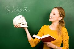 Girl holding skull and book Royalty Free Stock Photo