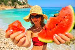 Girl holding slice of watermelon Stock Images