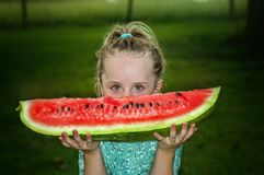 Girl holding slice of watermelon Royalty Free Stock Photography