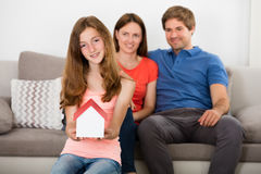 Girl Holding Small House Model Stock Image