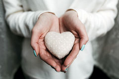 Girl holding a small lovely heart. (tiny things for a Valentine's day stock photos
