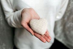 Girl holding a small lovely heart. (tiny things for a Valentine's day royalty free stock photography