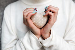 Girl holding a small lovely heart. (tiny things for a Valentine's day royalty free stock photos