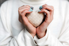 Girl holding a small lovely heart. (tiny things for a Valentine's day stock photography