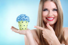 Girl  holding small pot with flowers Stock Photo