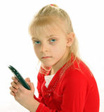 Girl holding smart phone. Half body portrait of young girl texting on smart phone, isolated on white background stock images