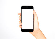 Girl holding smart phone in hand. White screen stock photos