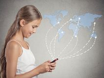 Girl holding smartphone browsing internet worldwide. Modern communication technology, mobile phone high tech, wide web connection concept. Happy girl holding royalty free stock image