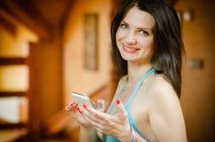 Girl holding smartphone Royalty Free Stock Photos