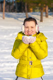 Girl holding snow Stock Photos