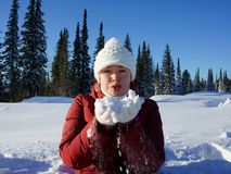 Girl is holding  snow on the hands. Royalty Free Stock Photos