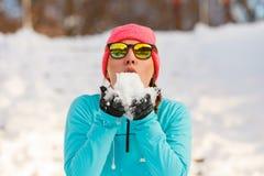 Girl holding snow in park Stock Image