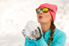 Girl holding snow in park Stock Photos