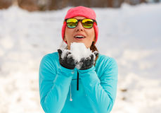 Girl holding snow in park Royalty Free Stock Photos