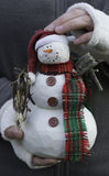 Girl holding a snowman in her hands Stock Photo