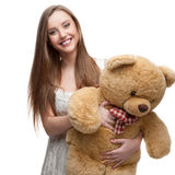 Girl holding soft toy bear Royalty Free Stock Photo