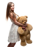 Girl holding soft toy bear Royalty Free Stock Image