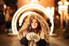 Girl holding a sparkler Royalty Free Stock Images