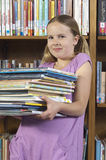 Girl Holding Stack Of Books Royalty Free Stock Image