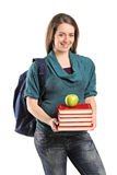 Girl holding a stack of books and an apple on top Royalty Free Stock Images