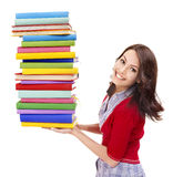 Girl holding stack color book . Stock Image