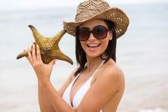 Girl holding starfish Stock Photography