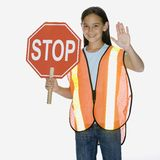 Girl holding stop sign. Young girl holding stop sign Royalty Free Stock Photography