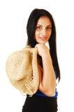 Girl holding straw hat. Stock Photos