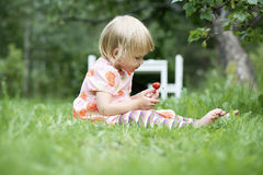 Girl holding a strawberry. Stock Photography
