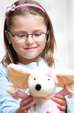Girl holding stuffed animal