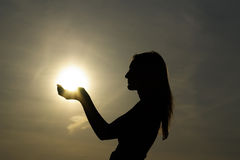 Girl holding sun royalty free stock photos