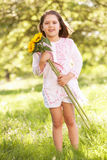 Girl Holding Sunflower In Field Royalty Free Stock Photography