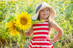 Girl holding sunflowers among field Royalty Free Stock Photos