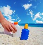 Girl holding a suntan bottle Stock Photo