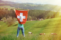 Girl holding Swiss flag Stock Photo