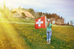 Girl holding Swiss flag Stock Photography